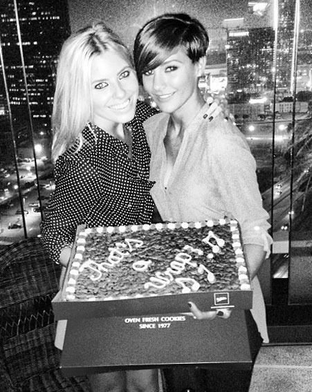 Mollie King and Frankie Sandford posed with a giant cookie at the Chasing The Saturdays wrap party