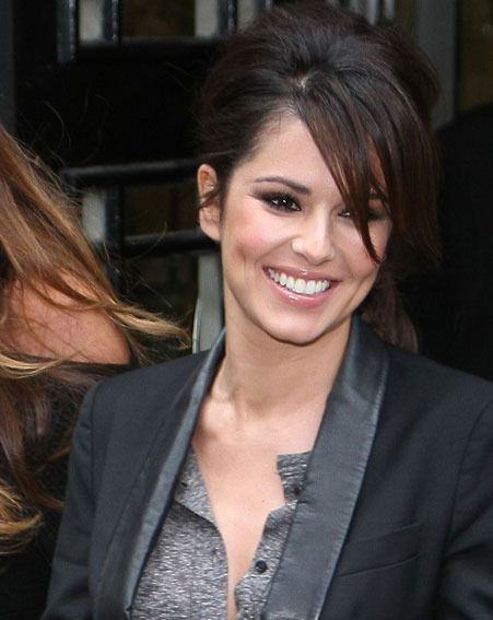 Cheryl Cole couldn't stop smiling when she arrived at the BBC Radio 1 studios today