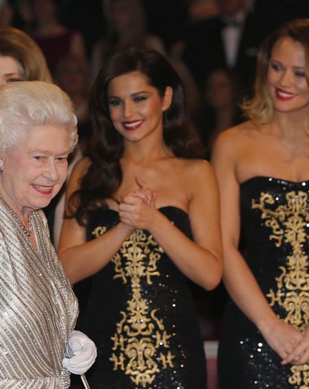 Cheryl Cole looked on as the Queen was introduced to the Royal Variety Performance acts