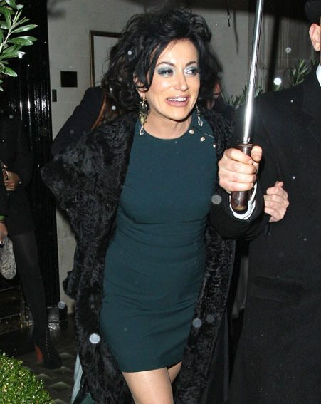 Nancy Dell'Olio  wore a short emerald green frock for her night out at Scotts restaurant in Mayfair