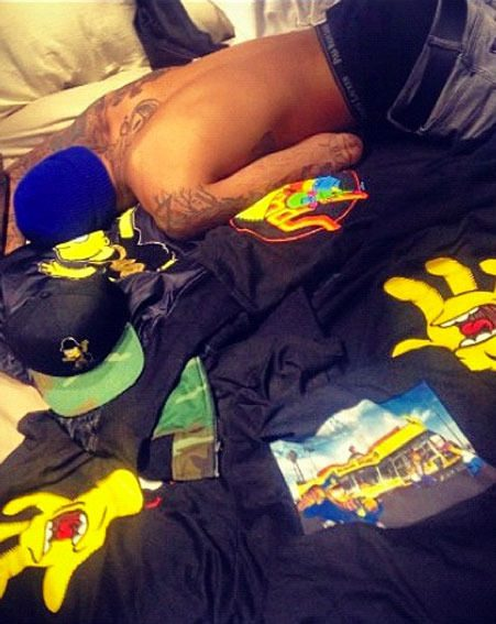 Rihanna posted this half naked picture of Chris Brown on Twitter yesterday