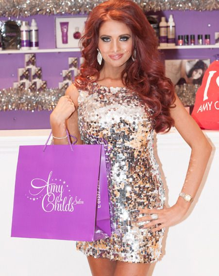 Amy Childs wore a dazzling silver sequined dress at the opening of her new salon