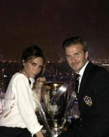 Victoria Beckham and hubby David posed with the LA Galaxy trophy for a Facebook picture