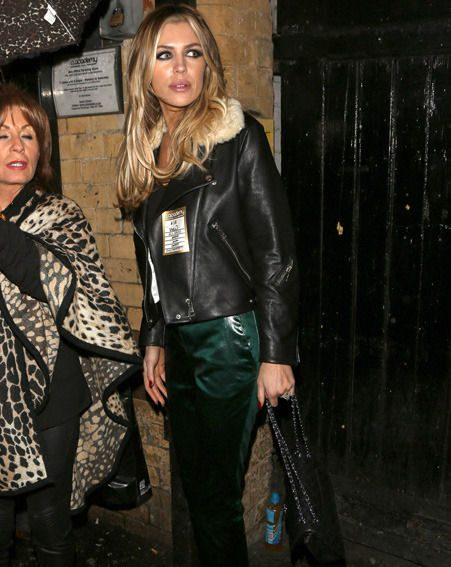 Abbey Clancy showed off her long legs in super-tight leather last night