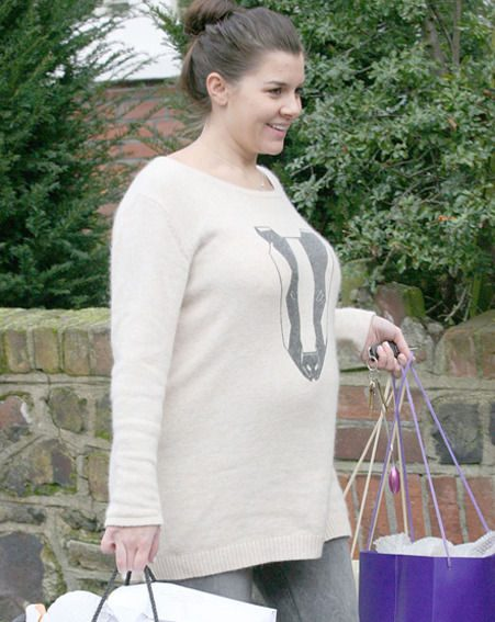 Imogen Thomas covered up her growing baby bump as she moved into her new house