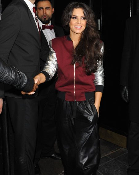 Cheryl Cole wore an unusual ensemble as she partied at the Rose Club last night