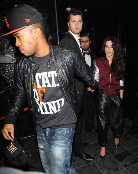 Cheryl Cole clutched on to Tre Holloway as the arrived at the west end club last night