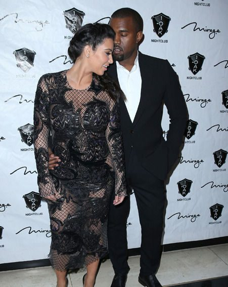 Kim Kardashian showed off her figrue in the sheer lace frock