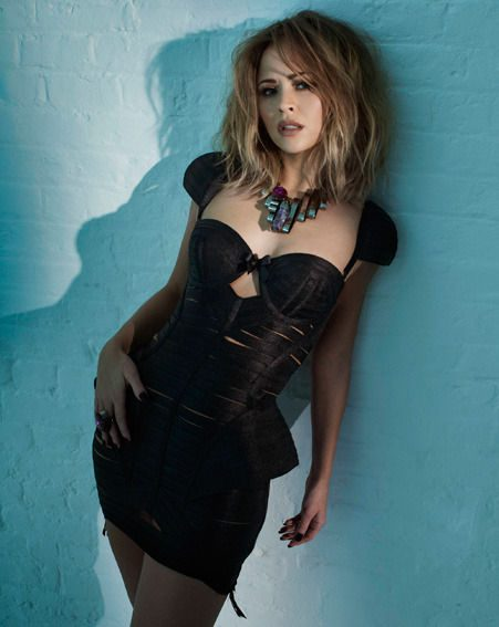 Girls Aloud beauty Kimberley Walsh looked seriously sassy in her all black attire