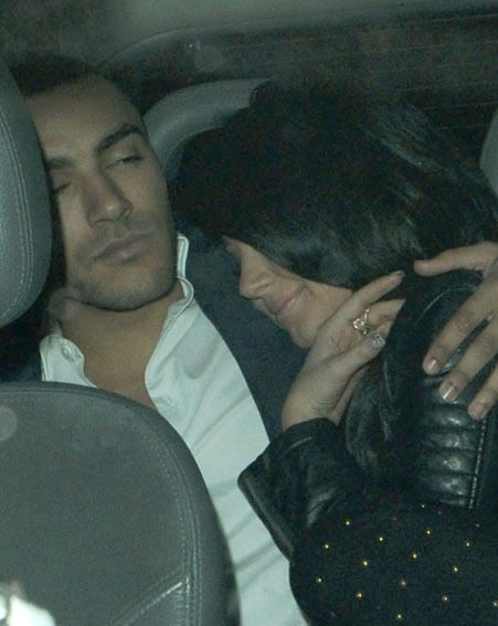 Tulisa snuggled up to Danny Simpson in the cab on their way home