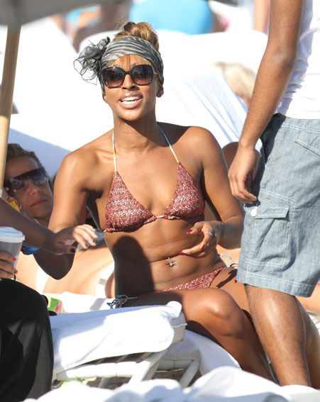 Alexandra Burke must have spent her Christmas in the gym to look THIS good in a bikini