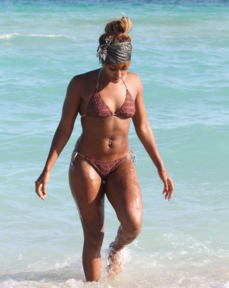Alexandra Burke showed off her toned body as she hit the beach in Miami