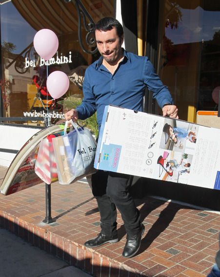 A clerk helps carry items after Skyfall star Adele went on a baby shopping spree in Beverly Hills