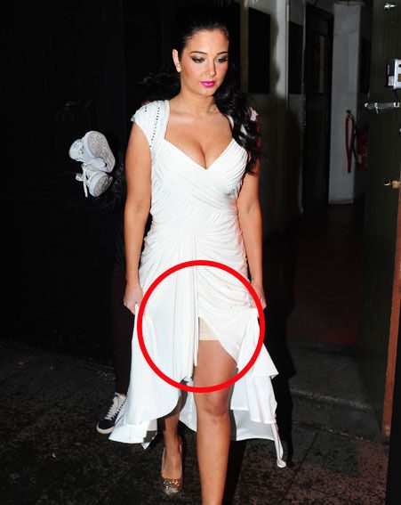 Tulisa showed off her knee-length Spanx when she left KOKO after the NTAs last night
