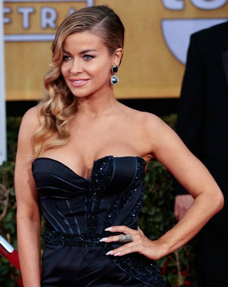 Carmen Electra flaunted her assets in the low-cut gown last night