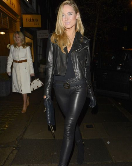 Kimberley Garner stepped out in a tight-fitting leather outfit while attending a private art display