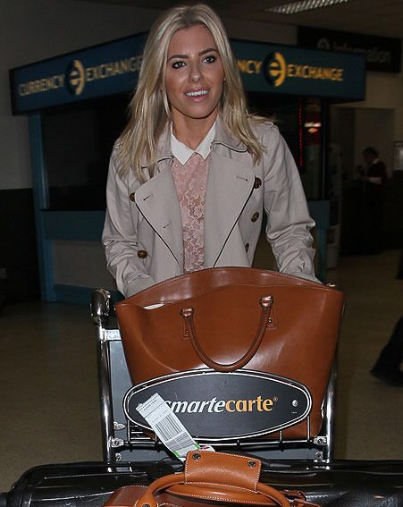 Mollie King arrived with an array of tan accessories at LAX airport