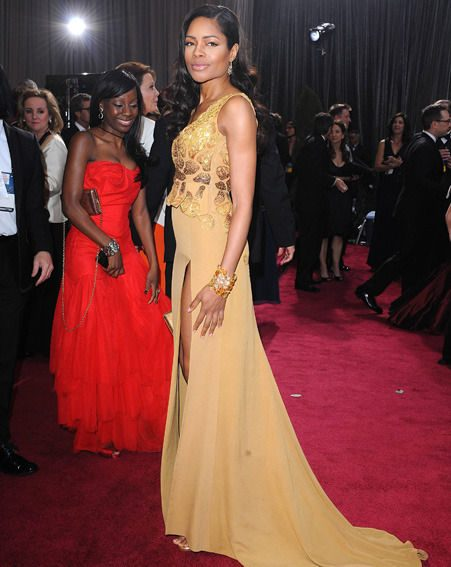 Naomie Harris beams as she's snapped in her gorgeous golden gown