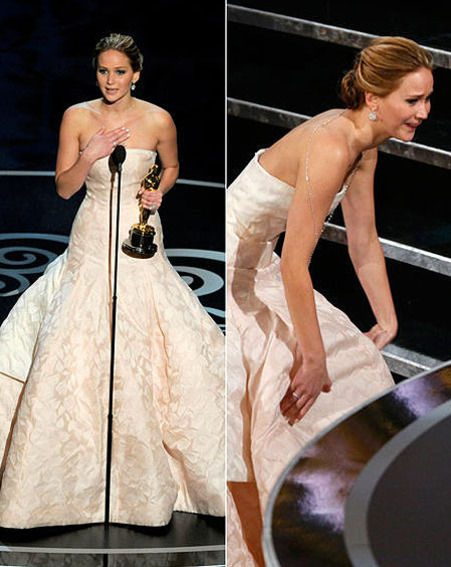Jennifer Lawrence takes a tumble as she makes her way to the Oscars stage